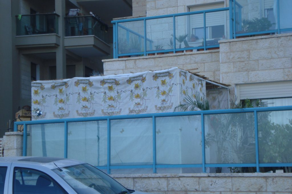 A Sukkah, a sort of tent with a flat top, on a balcony for Sukkot in Israel